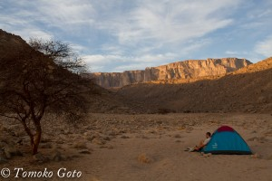 Pulling on my boots at sunrise (yeah, I woke up with the sun every day!). At our camp in the Wadi Wahesh.