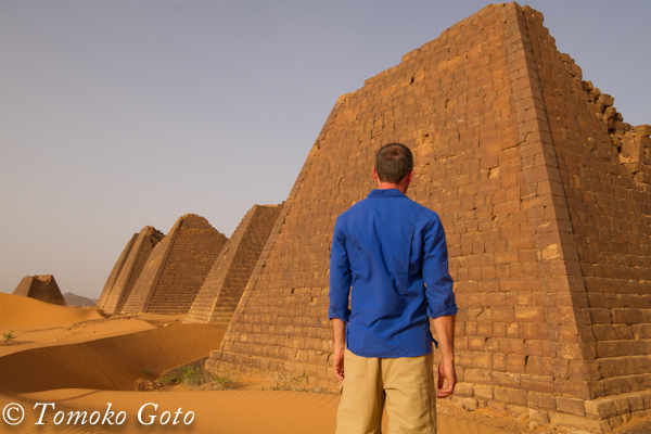 The pyramids of Meroe in blue and sand brown.