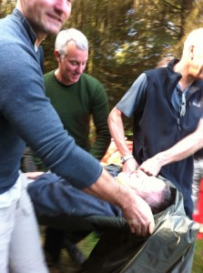 Evacuating a casualty on an improvised stretcher... He suddenly regained consciousness when I tried to steal his watch.