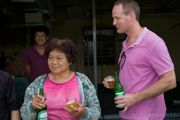 Sharing a beer with some very cheerful workers...