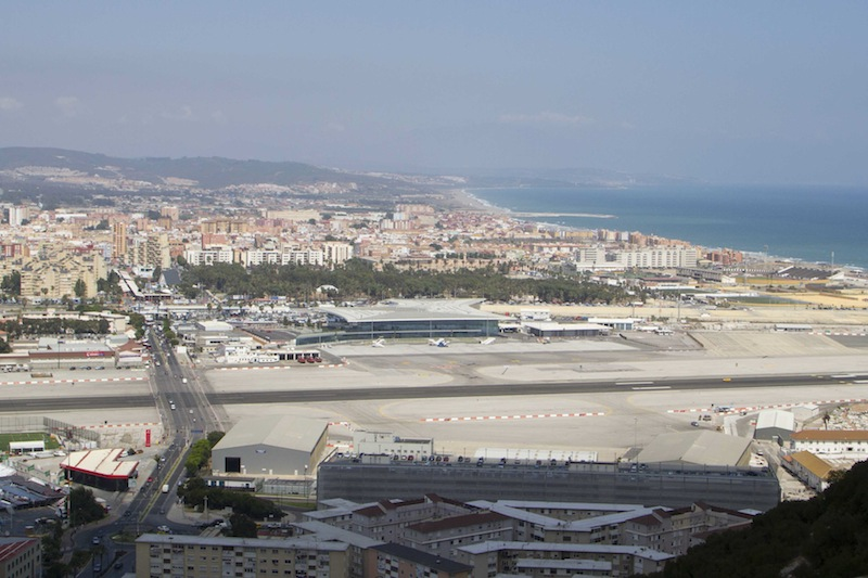 The airport in Gibraltar is right next to the border — and right in town