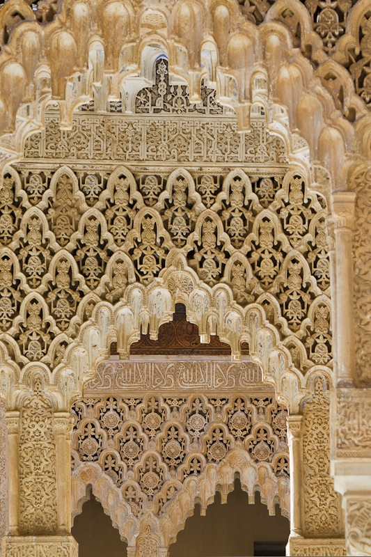 Plasterwork designs drip like stalactites from every wall and ceiling of the Nasrid Palace...
