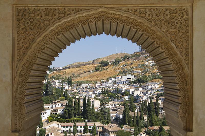 Arabesques grace a window offering gentle hillside views...