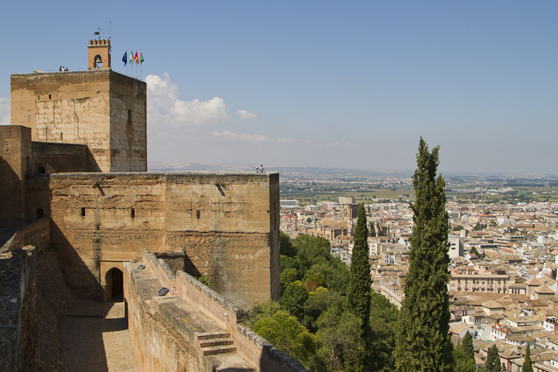 The tall defensive towers of the Alhambra's Alcazaba dominate the surrounding plains...