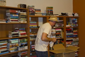 Unpacking my books.... yes I AM wearing a pith helmet.
