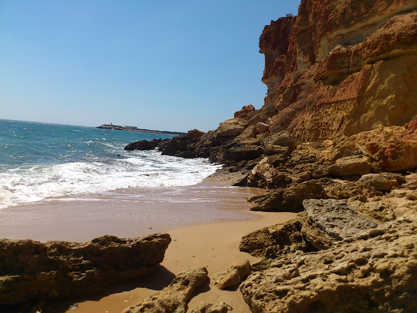 You won't find any tan lines at the peaceful little cove of Cala Camacho...