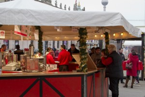 Buying a cup of Glühwein to warm my frozen bones...