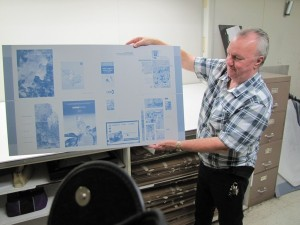 Gregg Molyneaux displays the latest proofs ready for the presses...