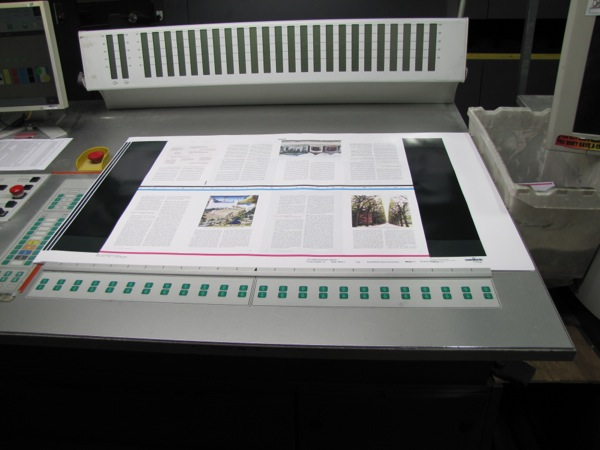 Quality control — magazine pages being run through the press...