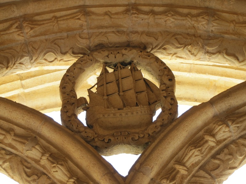 A caravel decorates the top of an arch in the cloister. This amazing new ship was capable of spanning the oceans, and it helped Portugal open the world...