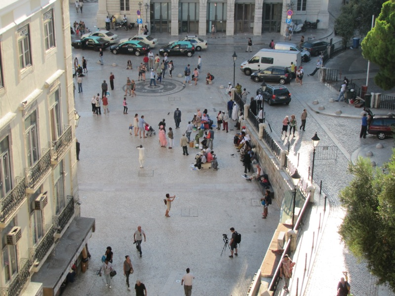 The plaza below my apartment is a popular gathering place for African immigrants...