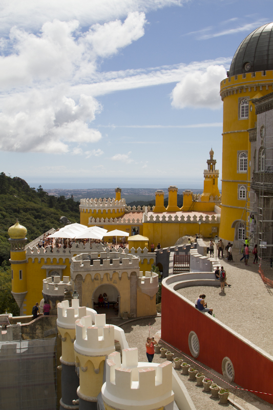 Pena Palace draws your eye the way that the sudden apparition of a fairy tale vision into our own reality would...