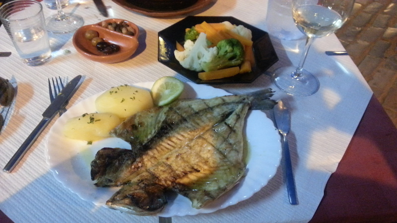 A lovely buttery dinner of grilled golden bream at a riverside place in Tavira...