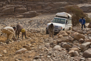 Creeping down a boulder-filled wadi, rebuilding the road as we went...