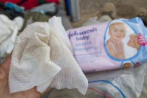 Washing with 3 wet wipes per day — why do they smell like baby puke?