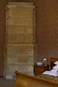 The rooms were heated by these massive wood-fired ceramic stoves...