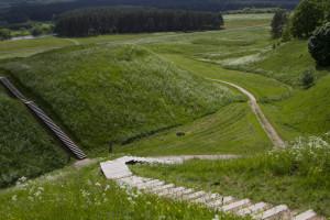 Wooden walkways thread their way between castle mounds...