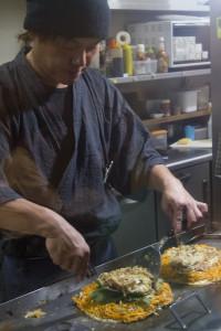 Hiroshima okonomiyaki is layered rather than mixed...