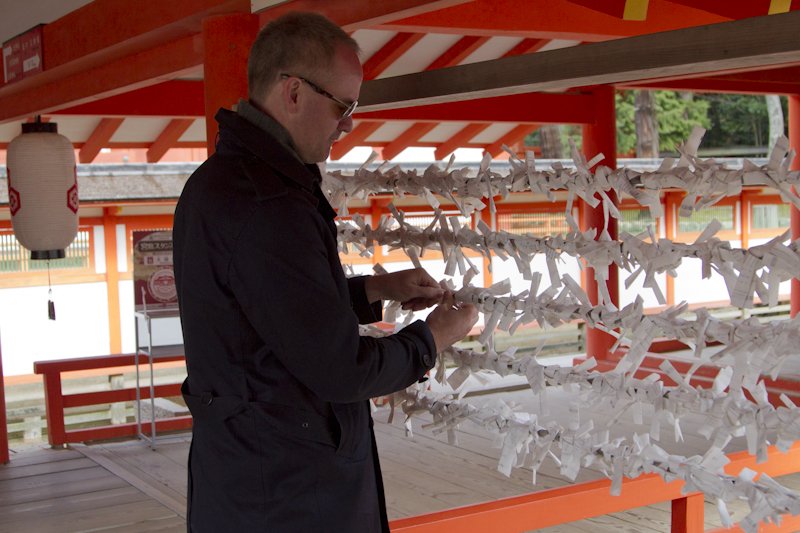 Leaving mediocre luck behind me as I tie my Omikuji to the railing...