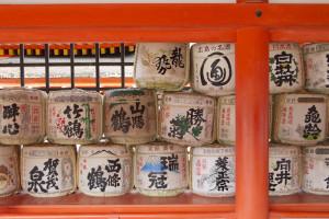 Wooden barrels of sake are left as offerings...