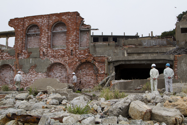 Engineers inspect the ruins of the mine's General Office building...