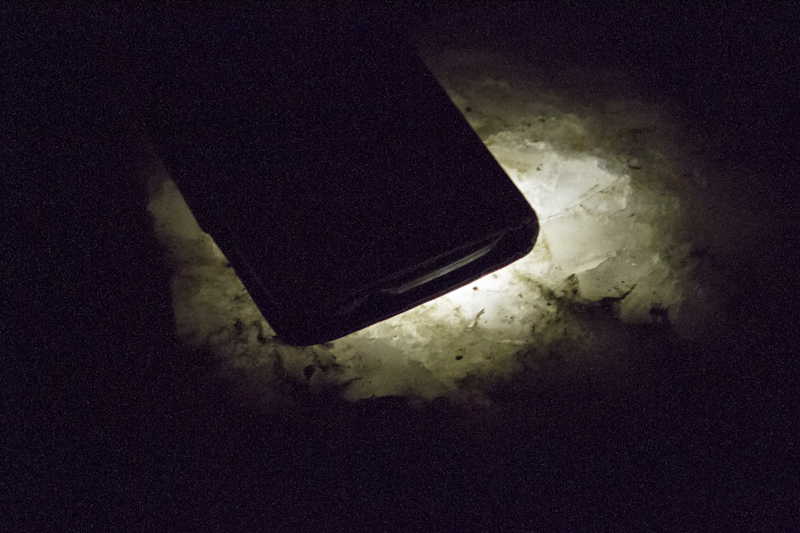 Salt crystals glow by the light of a torch...