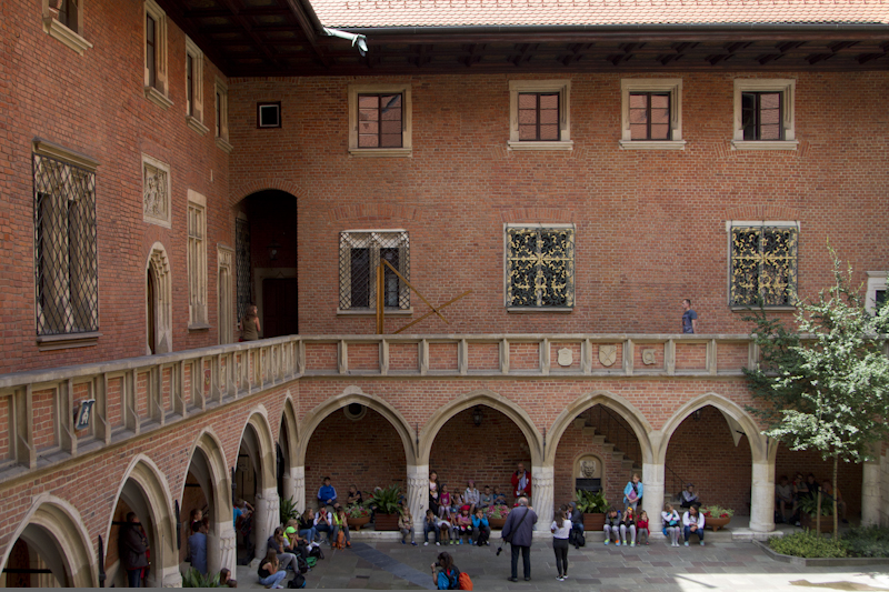 The elegant courtyard is surrounded by arches and cloisters...
