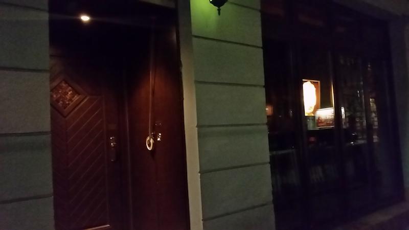 ...just an illuminated photo of the Irish novelist Samuel Beckett in the window, and a doorbell...