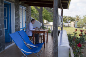 Writing these words to you on the veranda of our rented flat...
